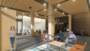 People standing and sitting on couches and chairs and benches in the main lobby of The 503, a commercial building in Portland, Oregon
